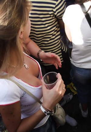 really stacked young woman holding drink downblouse pics