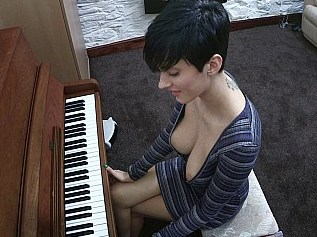 very pretty woman with great boobs sitting at piano downblouse pics